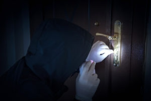 Burglar is forcing the door